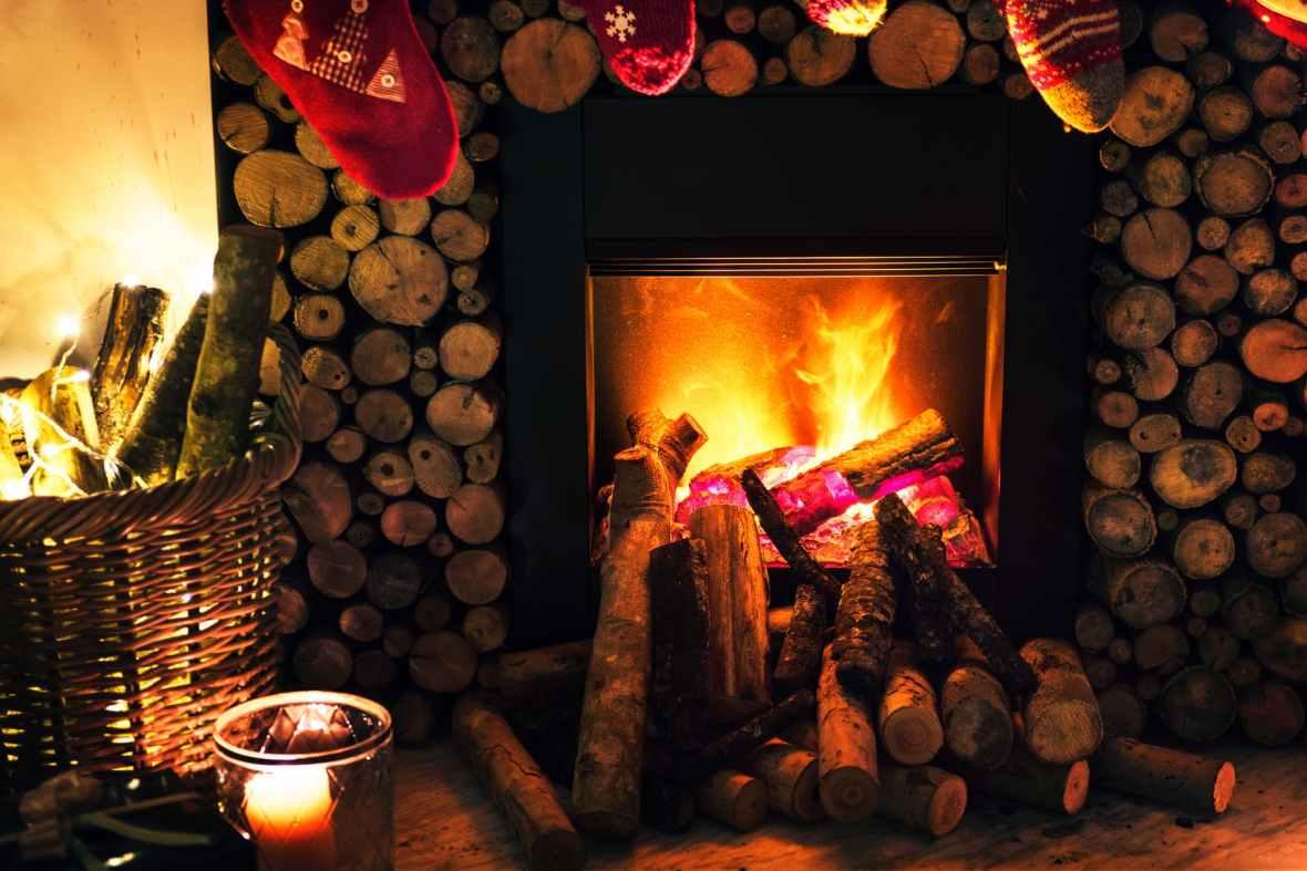 brown beside fireplace near brown wicker basket