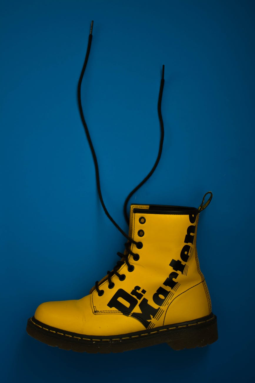 unpaired yellow dr martens lace up boot