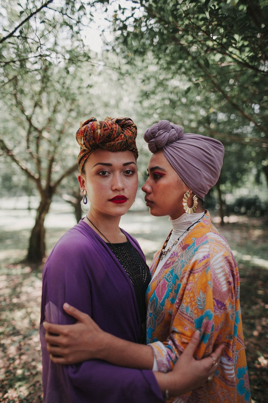 photo of two women standing outdoors wearing turban